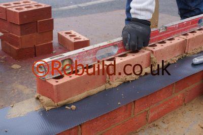 bricklayer building brick wall