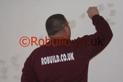 painter decorator filling cracks walls