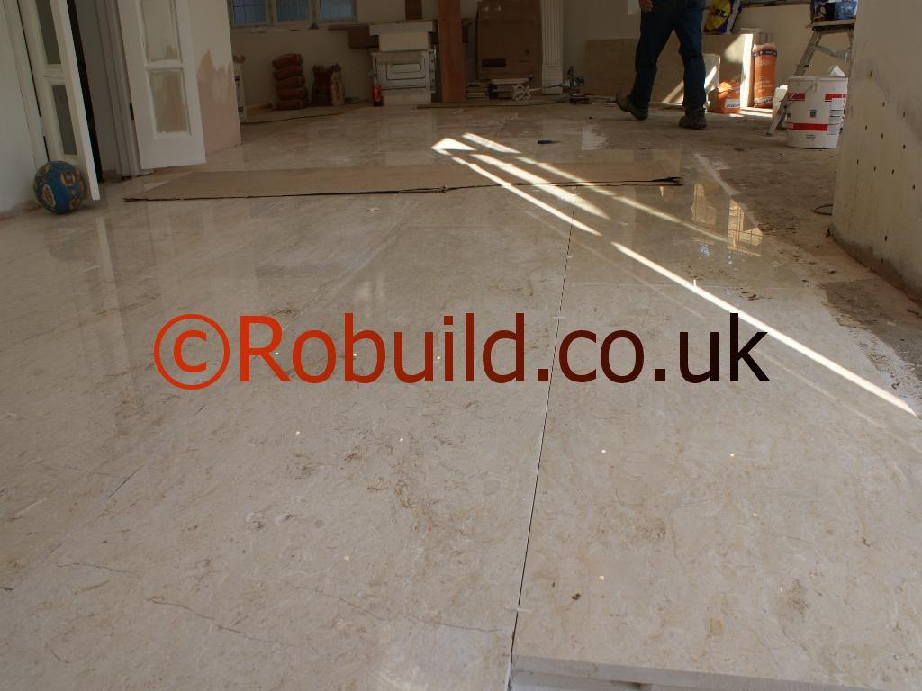 tiling marble floor tiles